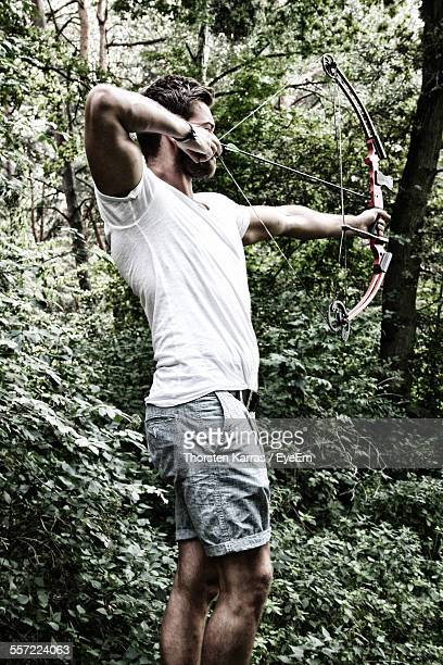 Archer Aiming In Forest