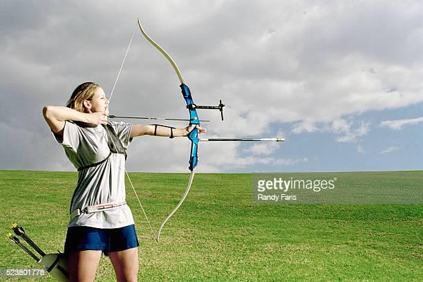 Archer Aiming in Open Field