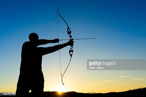 archer at sunset - longbow stock photos and pictures