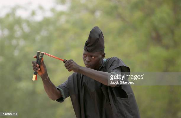 Archer competes with a sling shot on March 17 2004 at the Argungu Fishing Festival in Argungu Nigeria The Argungu Fishing Festival was first held in...