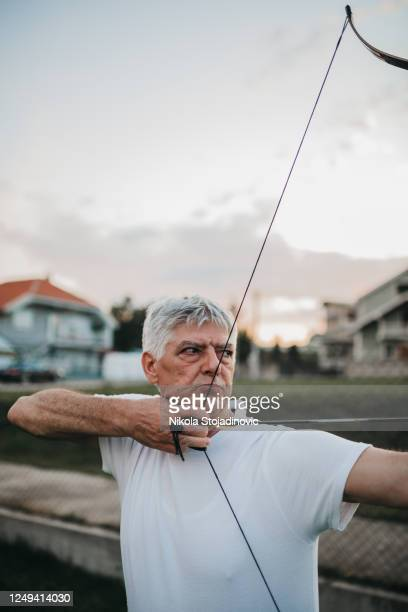 archer in training - longbow stock pictures, royalty-free photos & images