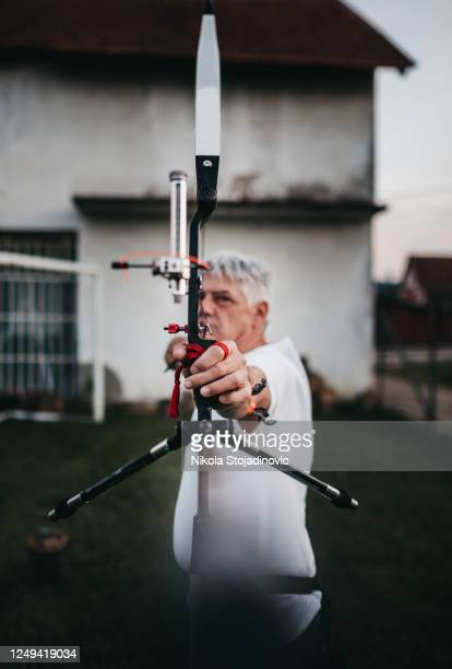 archer man training archery - longbow stock pictures, royalty-free photos & images