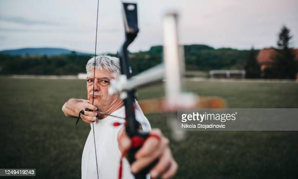 archer man training - longbow stock pictures, royalty-free photos & images