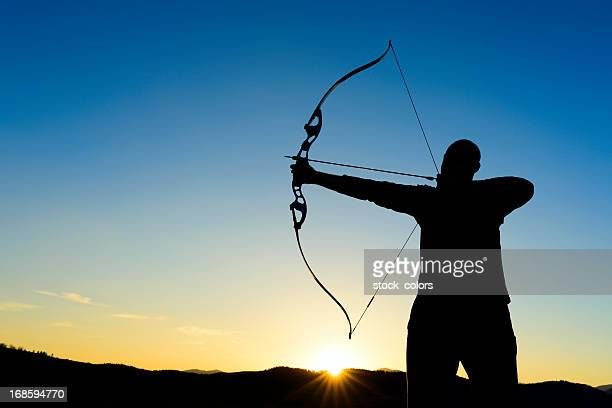 archer silhouette - longbow stock photos and pictures