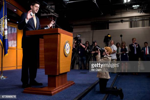 Archer Somodevilla son of Getty Images photojournalist Chip Somodevilla takes photos during Speaker of the House Paul Ryan's weekly news conference...