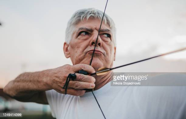 archer. sportsman practicing archery - longbow stock pictures, royalty-free photos & images