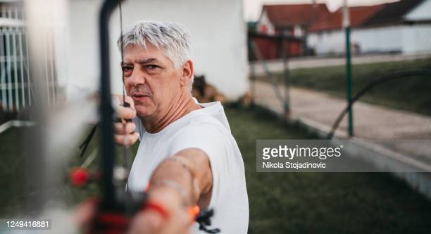 archer training with the bow - longbow stock pictures, royalty-free photos & images