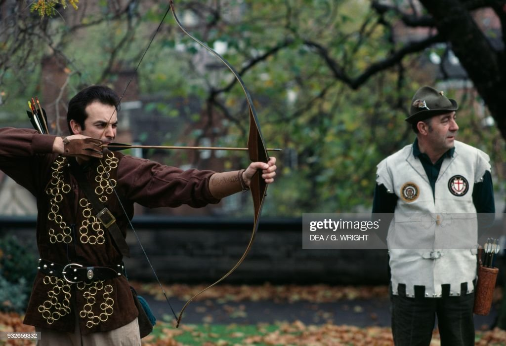 Archer with bow during historical reenactment of a Medieval Fair