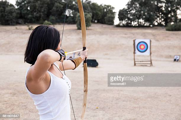 Archeress aiming at target