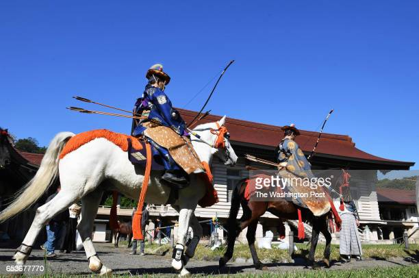 Archers from the Takeda School of Horseback Archery make their way to an area to perform a Yabusame archery demonstration on the grounds of the Meiji...