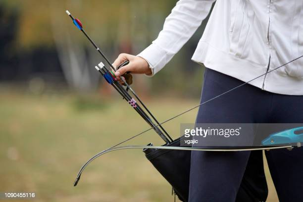 archery girl - longbow stock photos and pictures