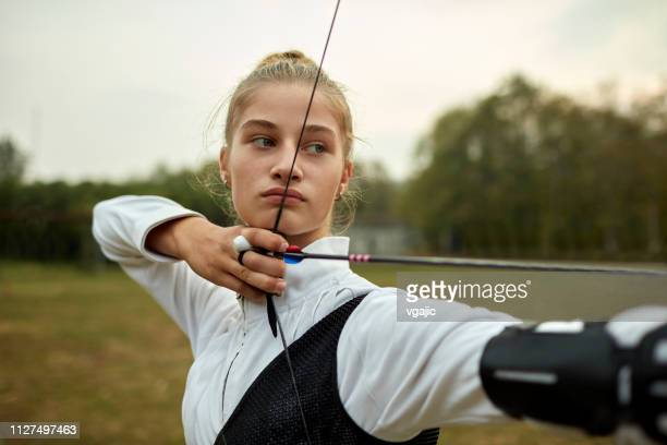 archery girl - archery stock pictures, royalty-free photos & images