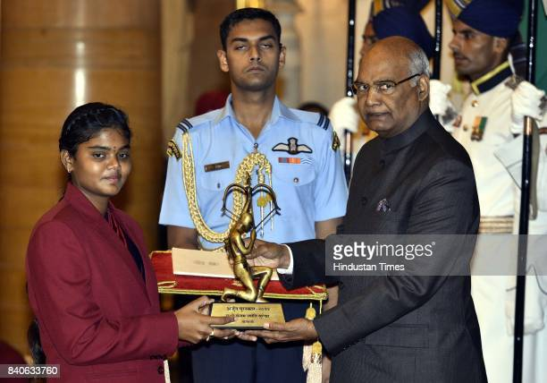 Archery player Jyothi Surekha Vennam accepts the Arjuna Award from President Ram Nath Kovind during the National Sports Awards ceremony at the...