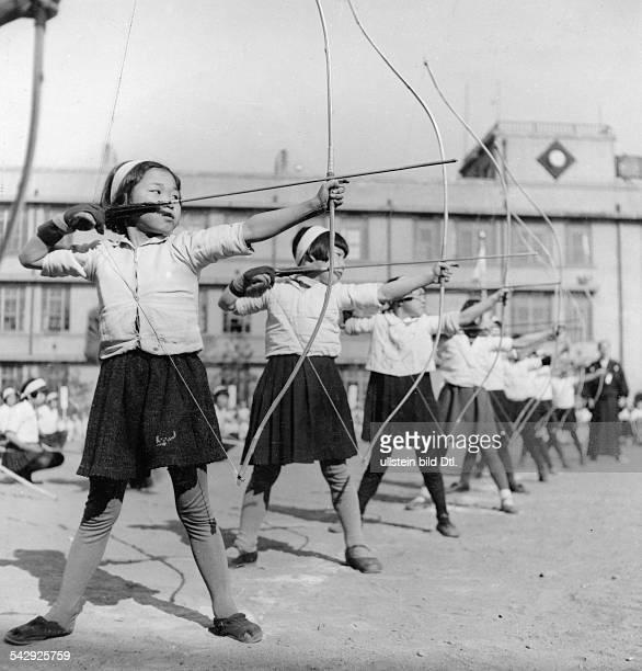 Archery pupils practising Kyudo Japanese martial art Published in Koralle 31 / 1943 Photographer Werner Cohnitz