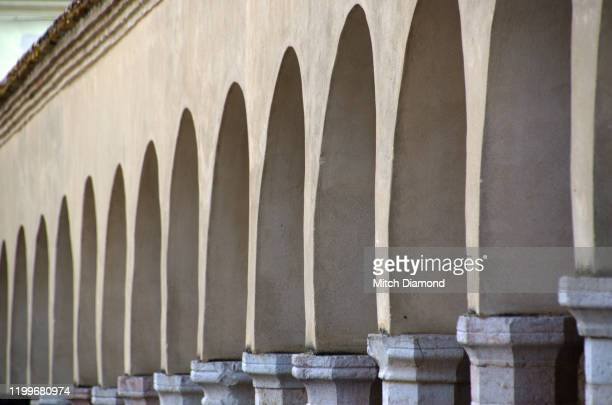 arches and columns medieval assisi architecture - assis ストックフォトと画像
