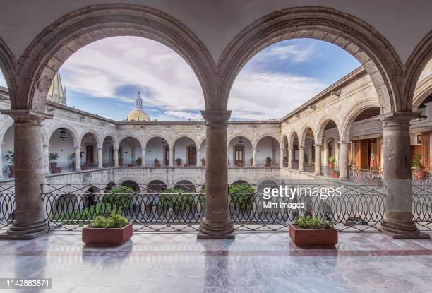 arches and courtyard of governor's palace, guadalajara, jalisco, mexico - guadalajara mexico stock pictures, royalty-free photos & images