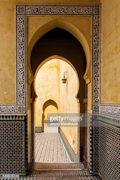 arches and mosaic tiling in muslim mausoleum - moroccan culture stock photos and pictures