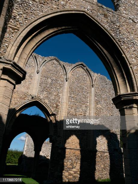 arches and shadows at creake abbey, norfolk - chert stock photos and pictures