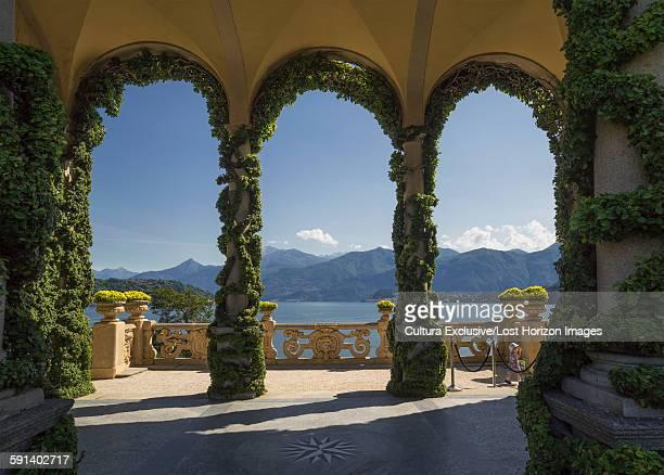 Arches in garden terrace of Villa del Balbianello, Lake Como, Italy