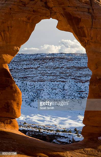 arches national park, utah. usa. view through delicate arch in winter. - delicate arch stock pictures, royalty-free photos & images