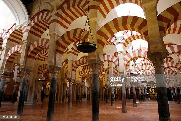 Arches of the Mosque Cathedral of Cordoba also called the Mezquita