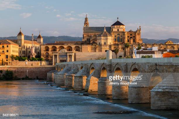 Arches of urban bridge in Cordoba cityscape, Andalusia, Spain