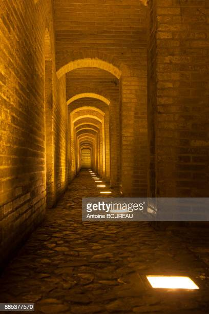 Arches under the Si-o-Seh bridge at night in Isfahan, Iran
