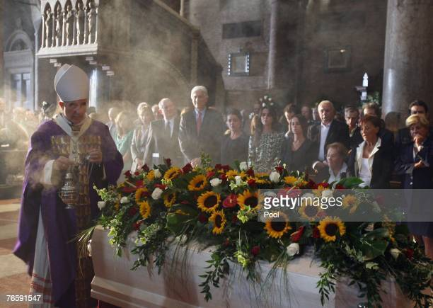 Archibishop Benito Cocchi blesses Luciano Pavarotti's coffin at the funeral held in Modena's Duomo on September 8 2007 in Modena Italy Pavarotti died...