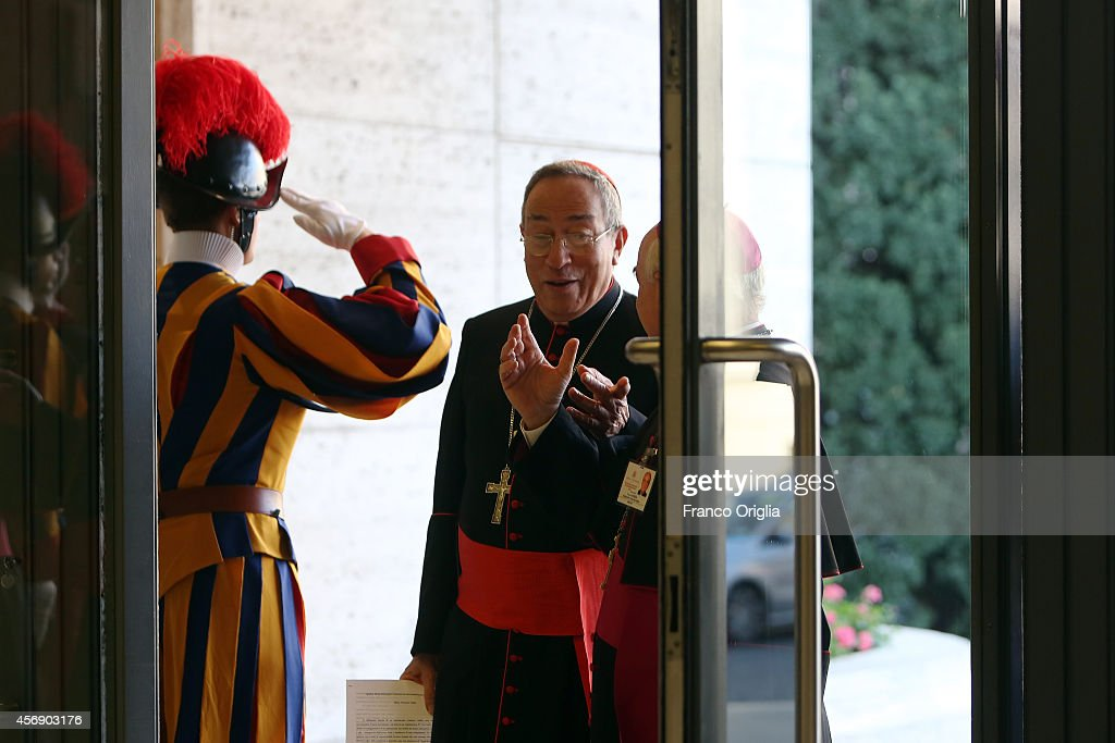 Archibishop of Tegucigalpa, Cardinal Oscar Andres Rodriguez Maradiaga arrives at the Synod Hall for the fourth day of the Synod on the themes of family on October 9, 2014 in Vatican City, Vatican. The issues discussed today were: 'what can the Church do to accompany families in difficult pastoral situations such as the separated, divorced or divorced and remarried, single parents, teen mothers, children from broken homes? What is the Churches pastoral outreach concerning unions of persons of the same sex?'