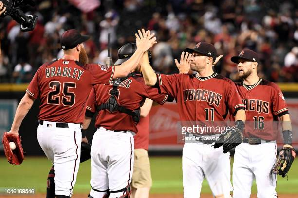 Archie Bradley AJ Pollock and Chris Owings of the Arizona Diamondbacks celebrate after closing out the MLB game against the San Diego Padres at Chase...