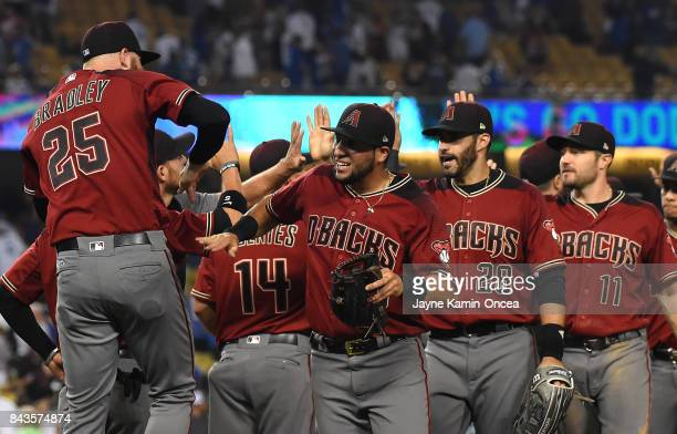 Archie Bradley Gregor Blanco JD Martinez and AJ Pollock of the Arizona Diamondbacks celebrate as the leave the field after the ninth inning of the...