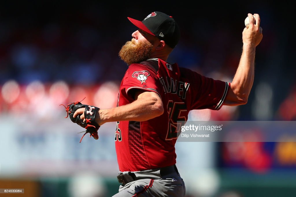 Archie Bradley #25 of the Arizona Diamondbacks delivers a pitch against the St. Louis Cardinals in the eighth inning at Busch Stadium on July 30, 2017 in St. Louis, Missouri.