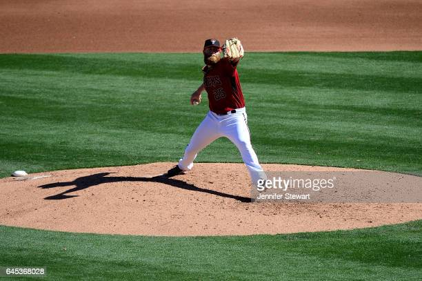 Archie Bradley of the Arizona Diamondbacks delivers a pitch during the spring training game against the Colorado Rockies at Salt River Fields at...