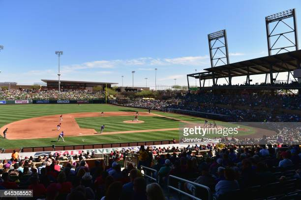 Archie Bradley of the Arizona Diamondbacks delivers a pitch during the fourth inning of the spring training game against the Colorado Rockies at Salt...