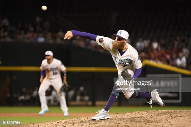 Archie Bradley of the Arizona Diamondbacks delivers a pitch in the eighth inning of the MLB game against the San Francisco Giants at Chase Field on...
