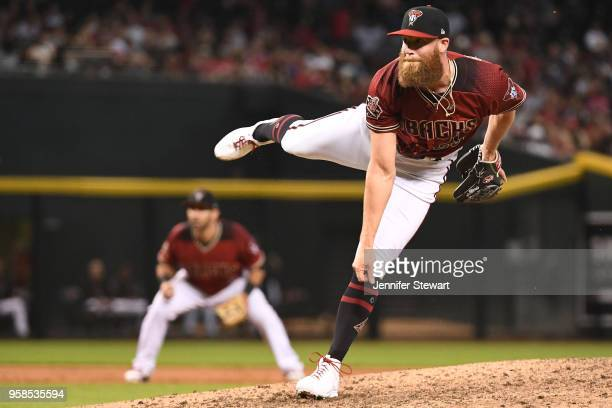 Archie Bradley of the Arizona Diamondbacks delivers a pitch in the eighth inning of the MLB game against the Houston Astros at Chase Field on May 6...