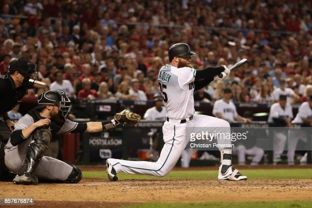 Archie Bradley of the Arizona Diamondbacks hits a RBI triple during the bottom of the seventh inning of the National League Wild Card game against...