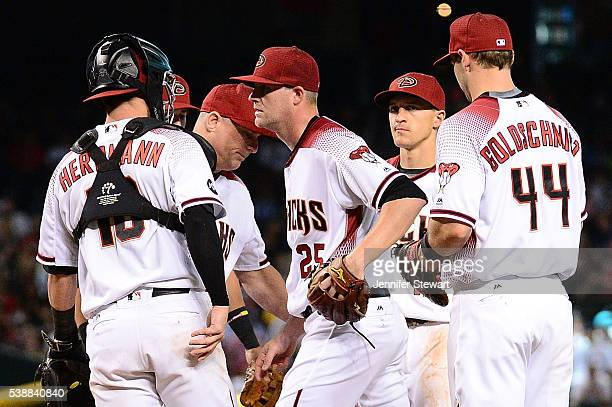 Archie Bradley of the Arizona Diamondbacks is relieved by manager Chip Hale in the sixth inning during the game against the Tampa Bay Rays at Chase...