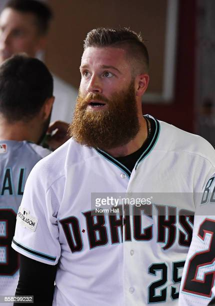Archie Bradley of the Arizona Diamondbacks looks at the scoreboard from the dugout after hitting a RBI triple in the bottom of the seventh inning...