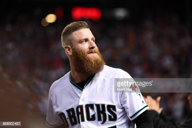 Archie Bradley of the Arizona Diamondbacks looks into the crowd from the dugout during the National League Wild Card Game against the Colorado...