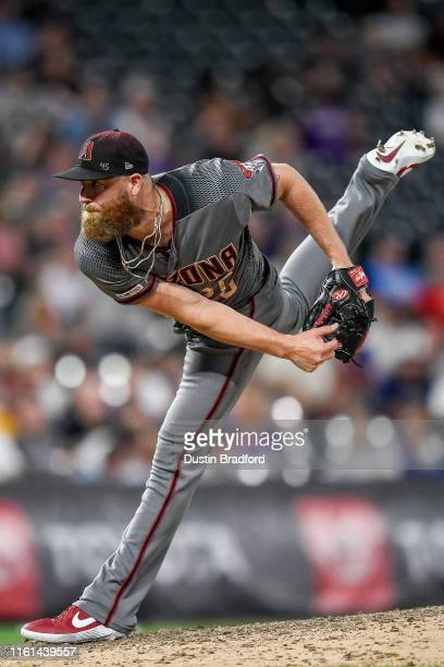 Archie Bradley of the Arizona Diamondbacks pitches against the Colorado Rockies in the ninth inning at Coors Field on August 12 2019 in Denver...