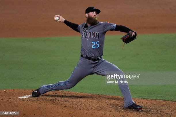 Archie Bradley of the Arizona Diamondbacks pitches during the ninth inning of a game against the Los Angeles Dodgers at Dodger Stadium on September 5...