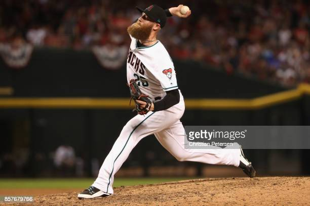 Archie Bradley of the Arizona Diamondbacks pitches during the top of the seventh inning of the National League Wild Card game against the Colorado...