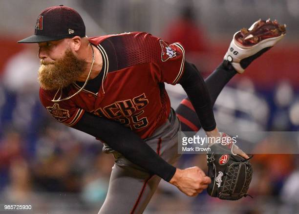 Archie Bradley of the Arizona Diamondbacks pitches in the eighth inning during the game against the Miami Marlins at Marlins Park on June 27 2018 in...