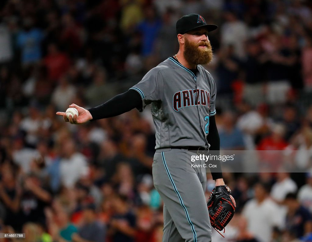 Archie Bradley #25 of the Arizona Diamondbacks reacts after Ender Inciarte #11 and Brandon Phillips #4 of the Atlanta Braves scored on a two-RBI single hit by Freddie Freeman #5 in the eighth inning at SunTrust Park on July 14, 2017 in Atlanta, Georgia.