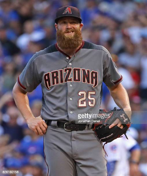 Archie Bradley of the Arizona Diamondbacks reacts after giving up a two run single in the 7th inning to Willson Contreras of the Chicago Cubs at...