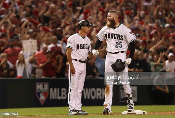 Archie Bradley of the Arizona Diamondbacks reacts after hitting a RBI triple during the seventh inning of the National League Wild Card game against...