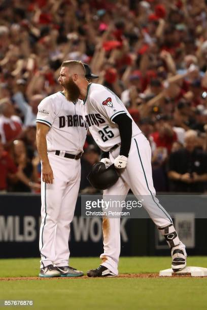 Archie Bradley of the Arizona Diamondbacks reacts after hitting aN RBI triple during the bottom of the seventh inning of the National League Wild...