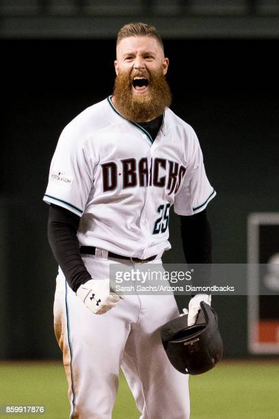 Archie Bradley of the Arizona Diamondbacks reacts after hitting an RBI triple during the National League Wild Card Game against the Colorado Rockies...