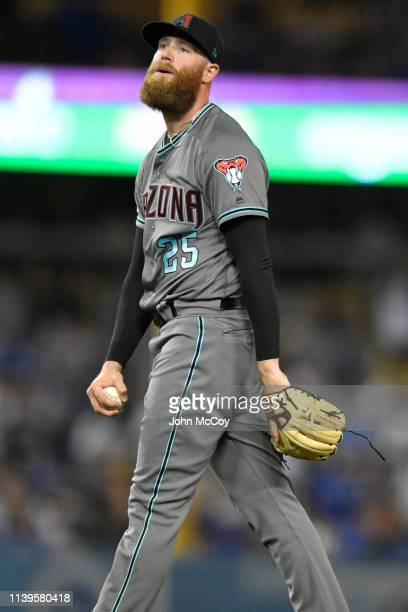 Archie Bradley of the Arizona Diamondbacks reacts to giving up a single to Justin Turner of the Los Angeles Dodgers in the eighth inning at Dodger...